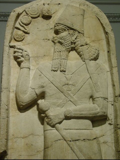 Anunnaki using Stargate Chamber. He's clearly pressing buttons on the wall, and it's no elevator! Also notice the Cross on his chest similar to Knights Templar Cross & German 'Iron Cross'  [They control Religions and Militaries ]